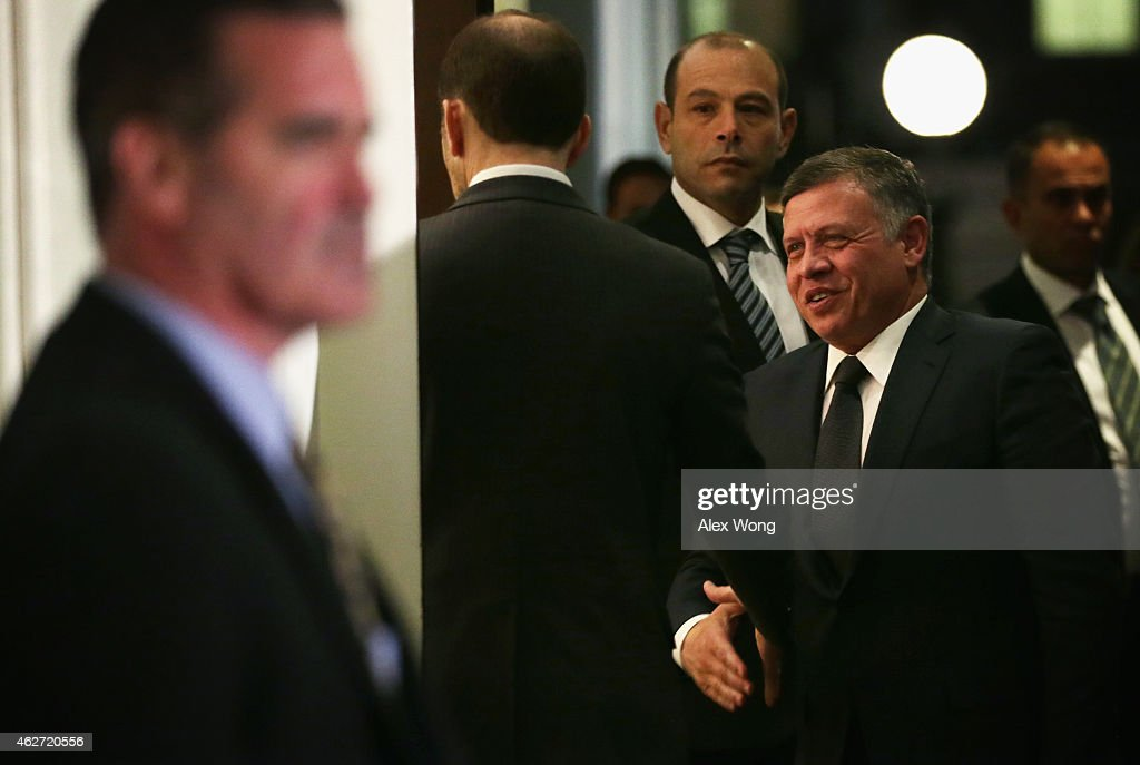 King Abdullah II of Jordan (2nd R) arrives at the West Wing of the White House for a meeting with U.S. President Barack Obama in the Oval Office of the White House February 3, 2015 in Washington, DC. The two leaders met after Islamic State released video that shows Jordanian pilot Muadh al-Kasasbeh being burned to death while locked in a cage.