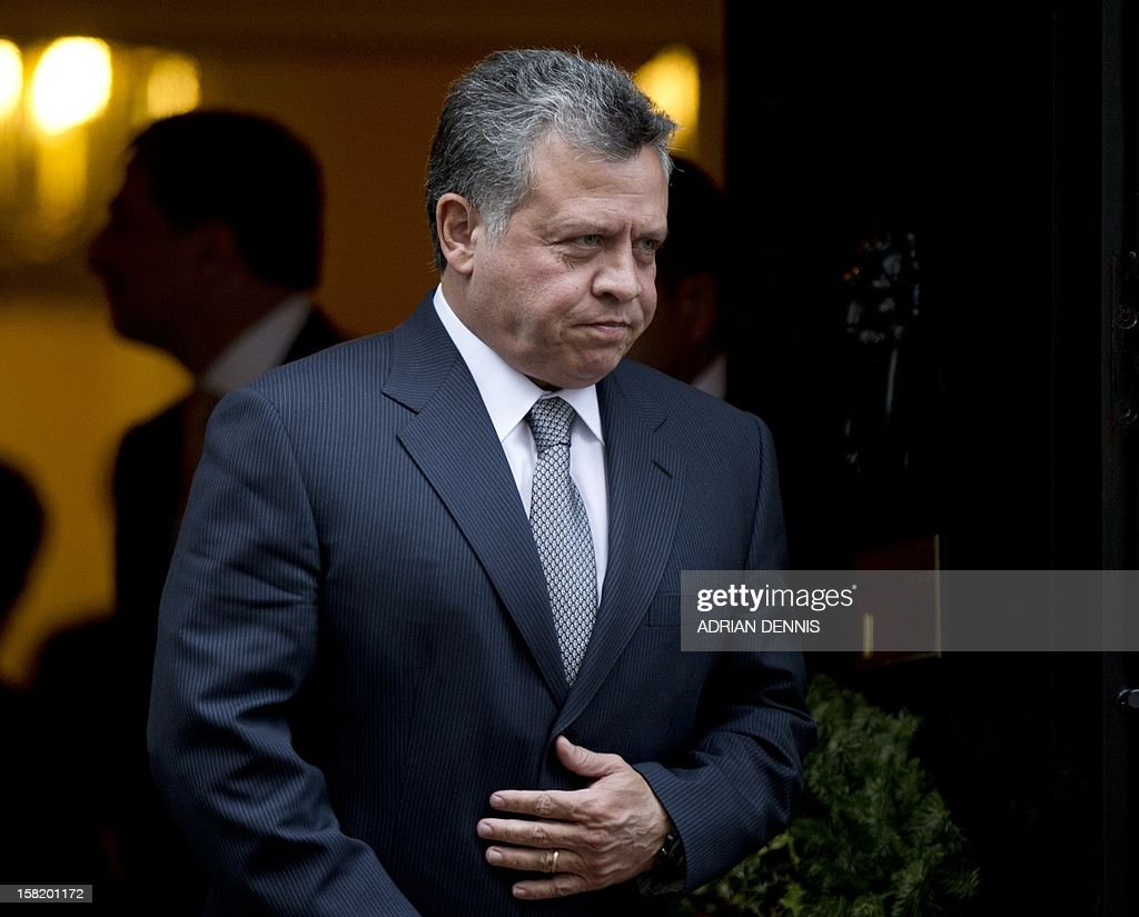 King Abdullah II of Jordan departs from No. 10 Downing Street following a meeting with Britain's Prime Minister David Cameron in London December 11, 2012.