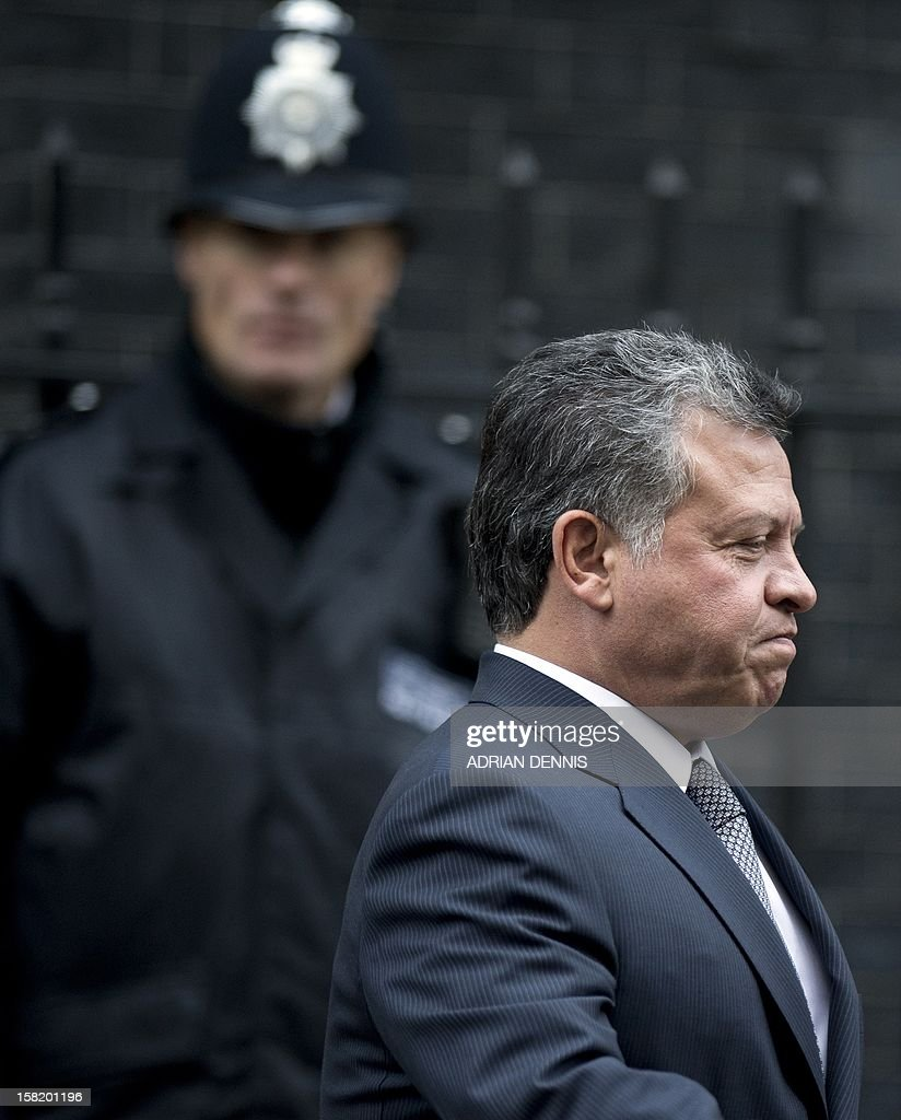 King Abdullah II of Jordan departs from No. 10 Downing Street following a meeting with Britain's Prime Minister David Cameron in London on December 11, 2012.