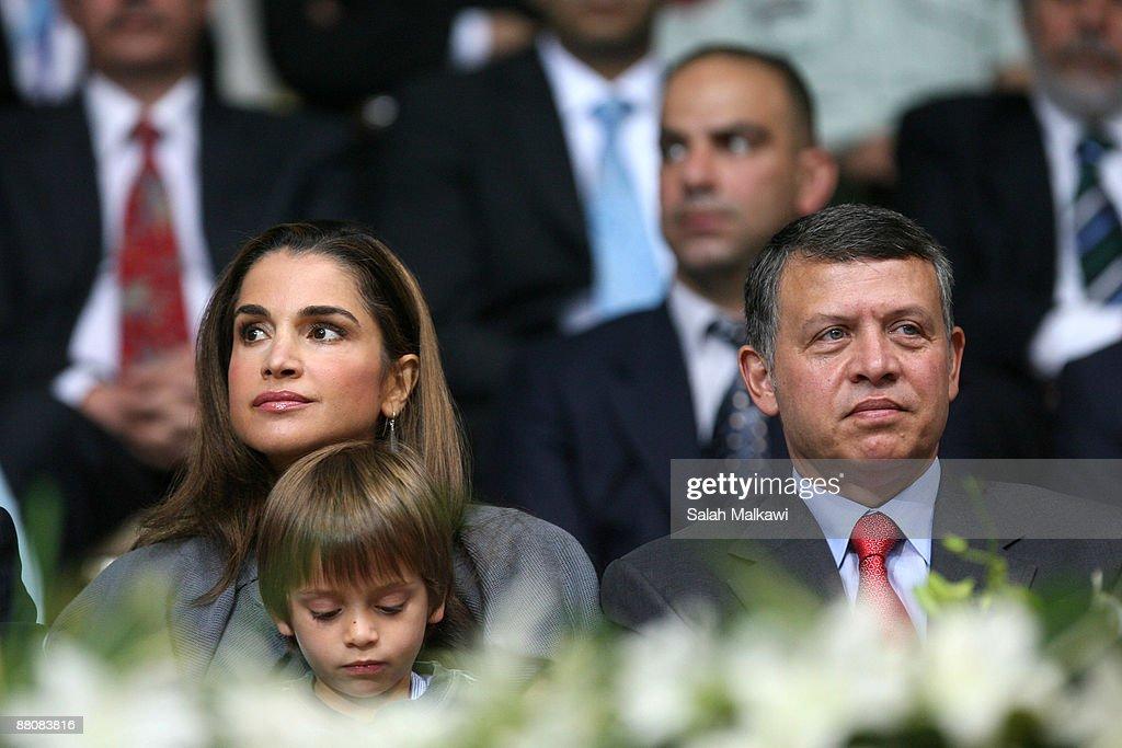 King Abdullah II of Jordan (R), his wife Queen Rania (L) and their son Prince Hashem bin Al Abdullah attend The King Abdullah Award for Fitness ceremony on May 31, 2009 in Amman, Jordan.