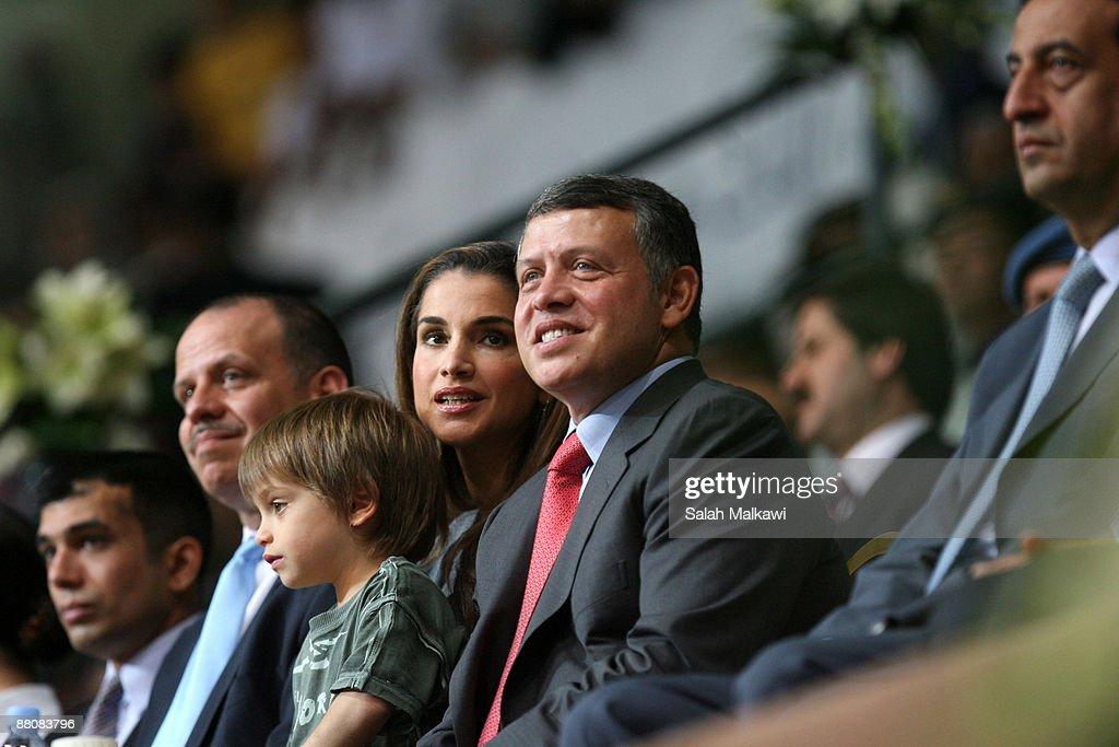 King Abdullah II of Jordan (2R), his wife Queen Rania (3R), their son Prince Hashem bin Al Abdullah (3L) and Prince Faisal Bin Al Hussein (2L) attend The King Abdullah Award for Fitness ceremony on May 31, 2009 in Amman, Jordan.