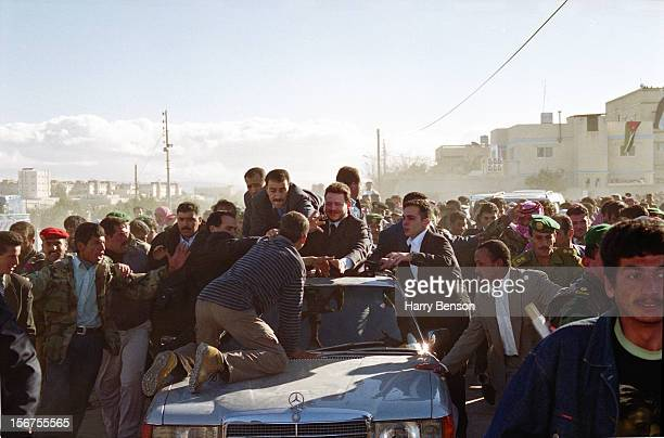 MA'AN JORDAN JANUARY 01 King Abdullah II of Jordan is photographed for Life Magazine in 2000 in Ma'an Jordan As a man jumps out of the crowd and...