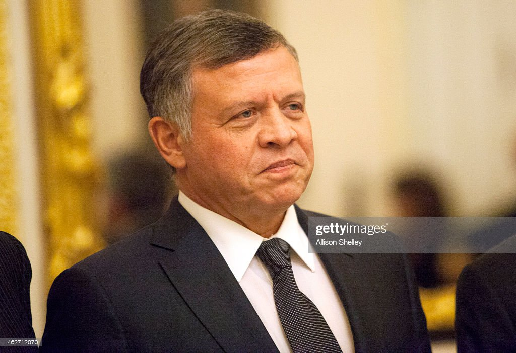 King Abdullah II of Jordan poses for a photo before meeting with members of the US Foreign Relations Committee February 3 2015 on Capitol Hill in...