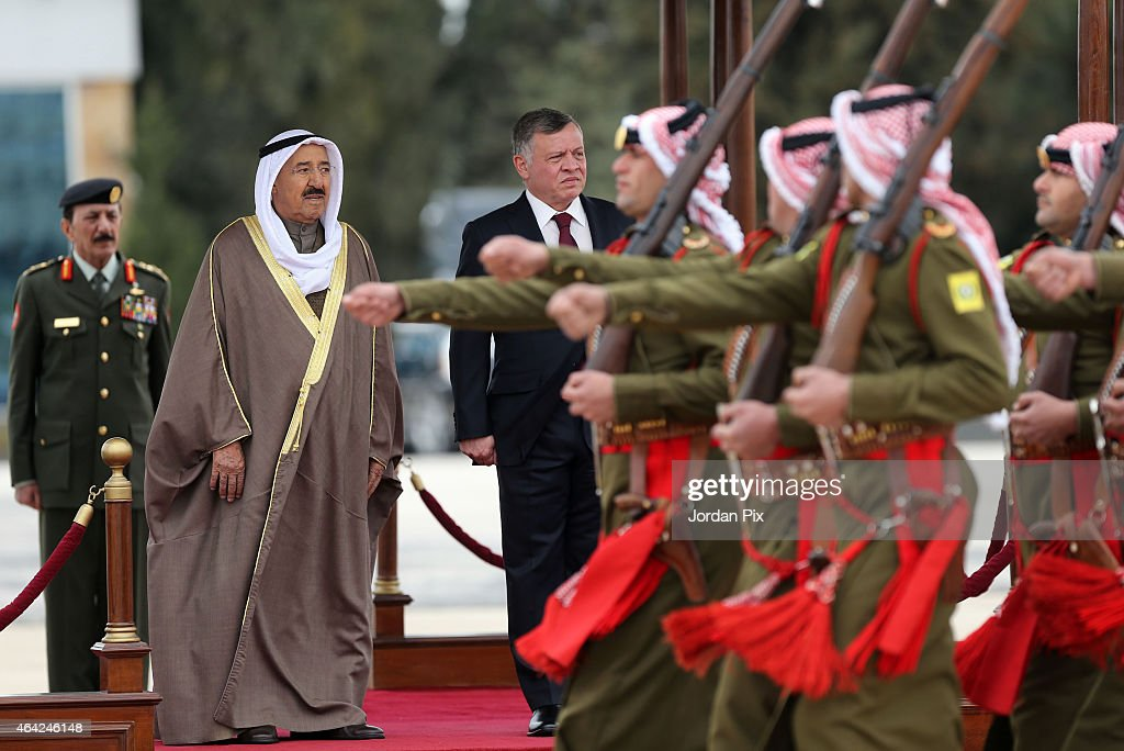 King Abdullah II of Jordan reviews the Bedouin honour guards as he welcomes Emir of Kuwait Sheikh <a gi-track='captionPersonalityLinkClicked' href=/galleries/search?phrase=Sabah+Al-Ahmad+Al-Jaber+Al-Sabah&family=editorial&specificpeople=5573991 ng-click='$event.stopPropagation()'>Sabah Al-Ahmad Al-Jaber Al-Sabah</a> (L) to Amman for talks on February 23, 2015 in Amman, Jordan. During their meeting, the two leaders are expected to discuss regional developments as well as strengthening their economic relationship.