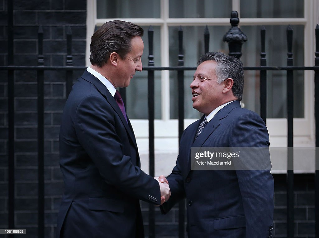 King Abdullah II of Jordan (R) shakes hands with Prime Minister <a gi-track='captionPersonalityLinkClicked' href=/galleries/search?phrase=David+Cameron+-+Homme+politique&family=editorial&specificpeople=227076 ng-click='$event.stopPropagation()'>David Cameron</a> outside 10 Downing Street on December 11, 2012 in London, England. King Abdullah, on a two day visit to London, is due to discuss the ongoing efforts to deport terror suspect Abu Qatada from Britain.