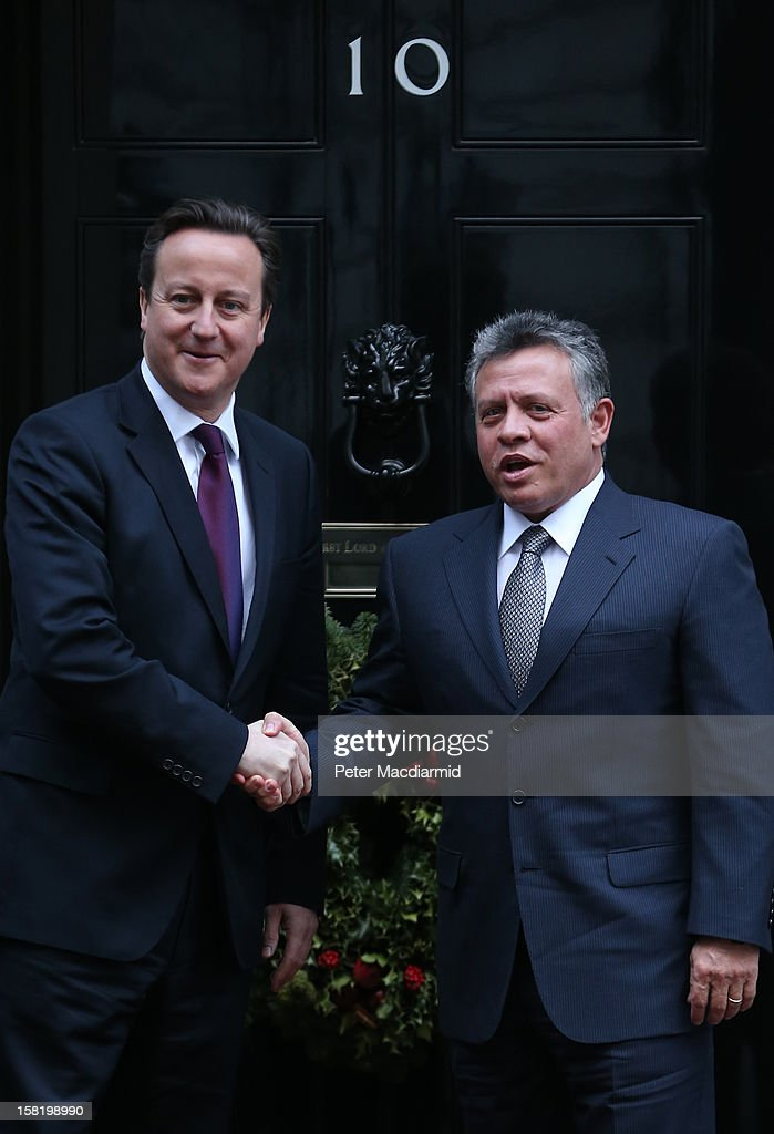King Abdullah II of Jordan (R) shakes hands with Prime Minister <a gi-track='captionPersonalityLinkClicked' href=/galleries/search?phrase=David+Cameron+-+Politico&family=editorial&specificpeople=227076 ng-click='$event.stopPropagation()'>David Cameron</a> outside 10 Downing Street on December 11, 2012 in London, England. King Abdullah, on a two day visit to London, is due to discuss the ongoing efforts to deport terror suspect Abu Qatada from Britain.