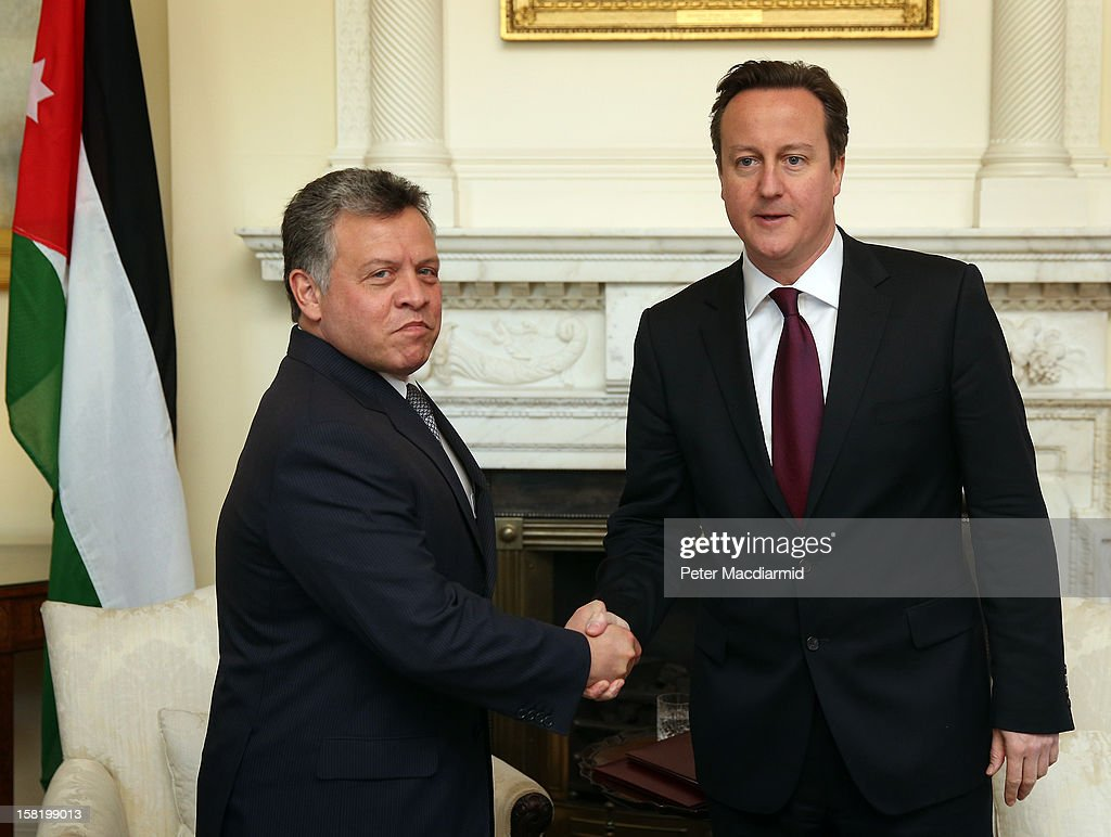 King Abdullah II of Jordan (L) shakes hands with Prime Minister <a gi-track='captionPersonalityLinkClicked' href=/galleries/search?phrase=David+Cameron+-+Politiker&family=editorial&specificpeople=227076 ng-click='$event.stopPropagation()'>David Cameron</a> inside 10 Downing Street on December 11, 2012 in London, England. King Abdullah, on a two day visit to London, is due to discuss the ongoing efforts to deport terror suspect Abu Qatada from Britain.