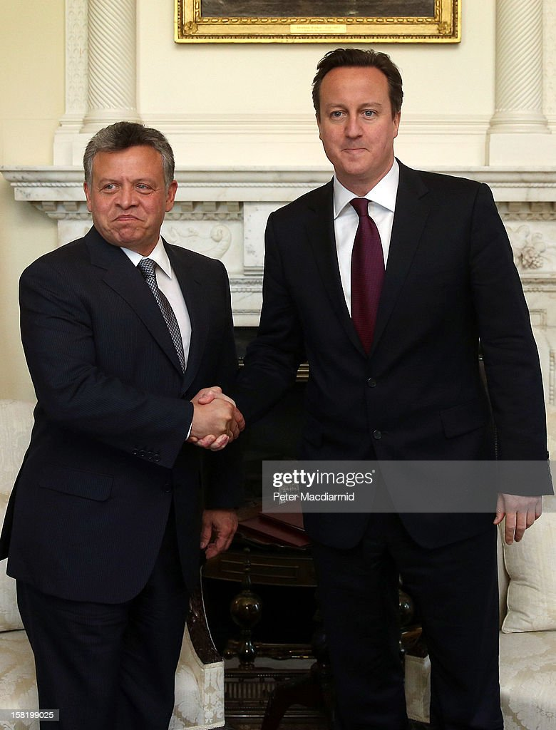 King Abdullah II of Jordan (L) shakes hands with Prime Minister <a gi-track='captionPersonalityLinkClicked' href=/galleries/search?phrase=David+Cameron+-+Homme+politique&family=editorial&specificpeople=227076 ng-click='$event.stopPropagation()'>David Cameron</a> inside 10 Downing Street on December 11, 2012 in London, England. King Abdullah, on a two day visit to London, is due to discuss the ongoing efforts to deport terror suspect Abu Qatada from Britain.