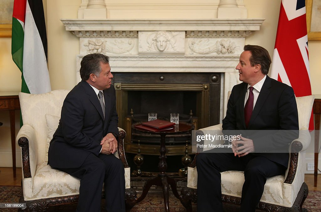 King Abdullah II of Jordan (L) speaks with Prime Minister <a gi-track='captionPersonalityLinkClicked' href=/galleries/search?phrase=David+Cameron+-+Pol%C3%ADtico&family=editorial&specificpeople=227076 ng-click='$event.stopPropagation()'>David Cameron</a> inside 10 Downing Street on December 11, 2012 in London, England. King Abdullah, on a two day visit to London, is due to discuss the ongoing efforts to deport terror suspect Abu Qatada from Britain.