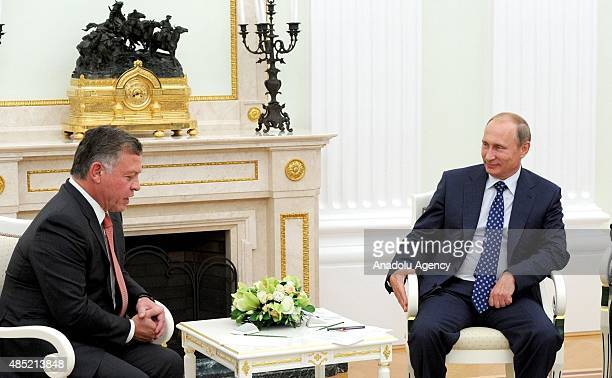 King Abdullah II of Jordan speaks with Russian President Vladimir Putin during their meeting at the Moscow International Aviation and Space Salon...