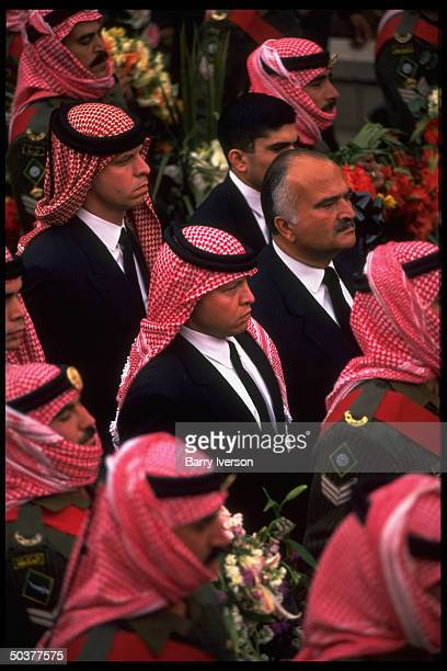 King Abdullah II of Jordan walking alongside his uncle former Crown Prince Hassan during funeral procession for his father King Hussein