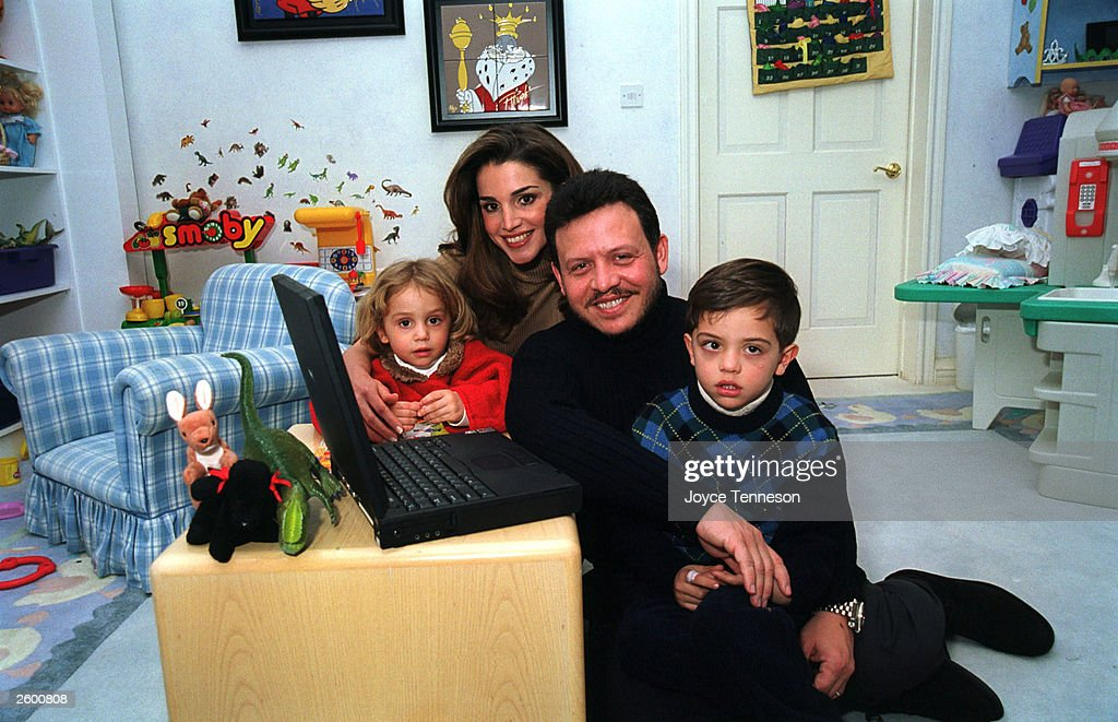 King Abdullah II Queen Rania sits with their sonHussein and daughter Iman on February 10 2000 in Ahman Jordan