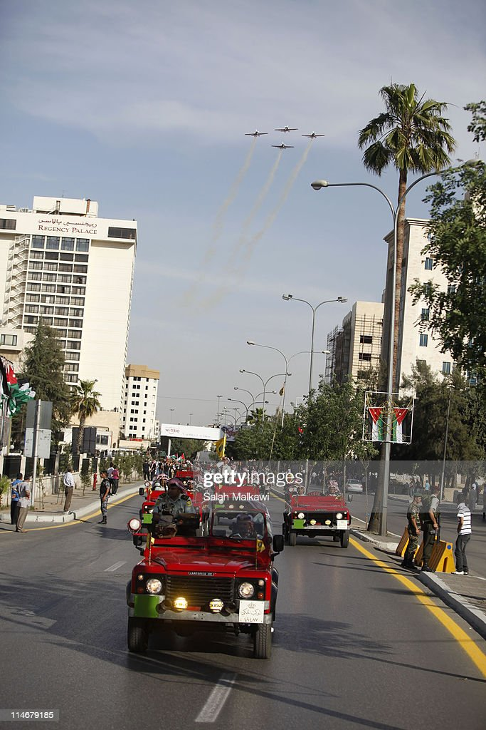 King Abdullah of Jordan arrives in a motorcade for an official celebration for the 65th anniversary of Independence on May 25, 2011 in Amman, Jordan. The Hashemite Kingdom of Jordan gained independence from Britain on May 25, 1946.