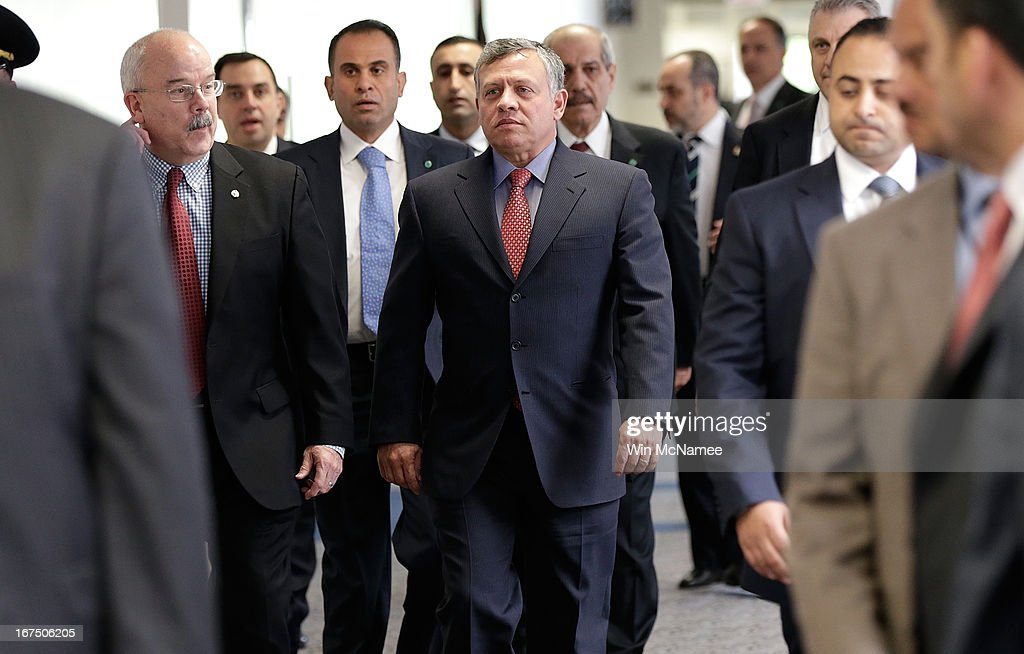 King Abdullah of Jordan is escorted to a briefing before the Senate Select Committee on Intelligence on Capitol Hill April 25, 2013 in Washington, DC. Abdullah and members of the U.S. Senate received a briefing from the U.S. intelligence community.