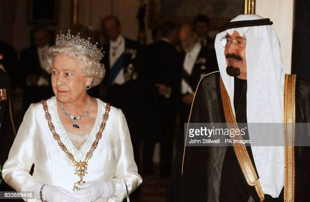 King Abdullah of Saudi Arabia with Queen Elizabeth II before the State Banquet at Buckingham Palace in London after the first day of the Saudi Kings...