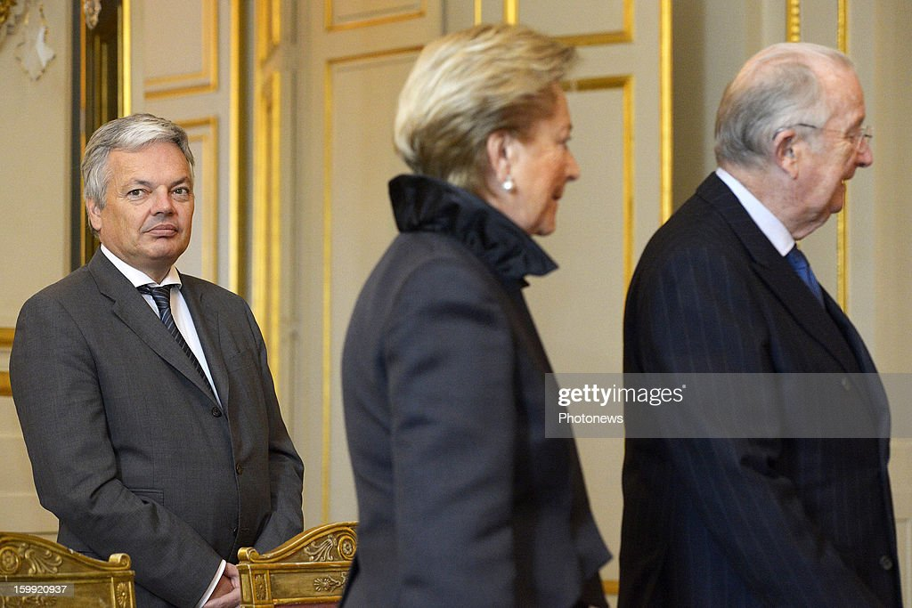 King Albert and Queen Paola pictured with Minister Didier Reynders during the reception at Royal Palace for European institutions on January 23, 2013 in Brussels, Belgium.