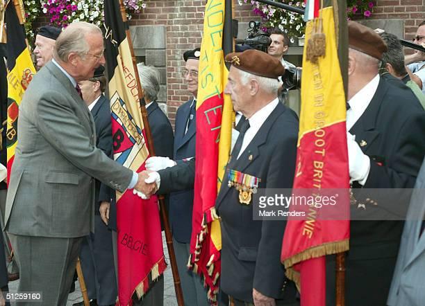 King Albert greets World War II veterans during a visit September 3 2004 in Hasselt Belgium