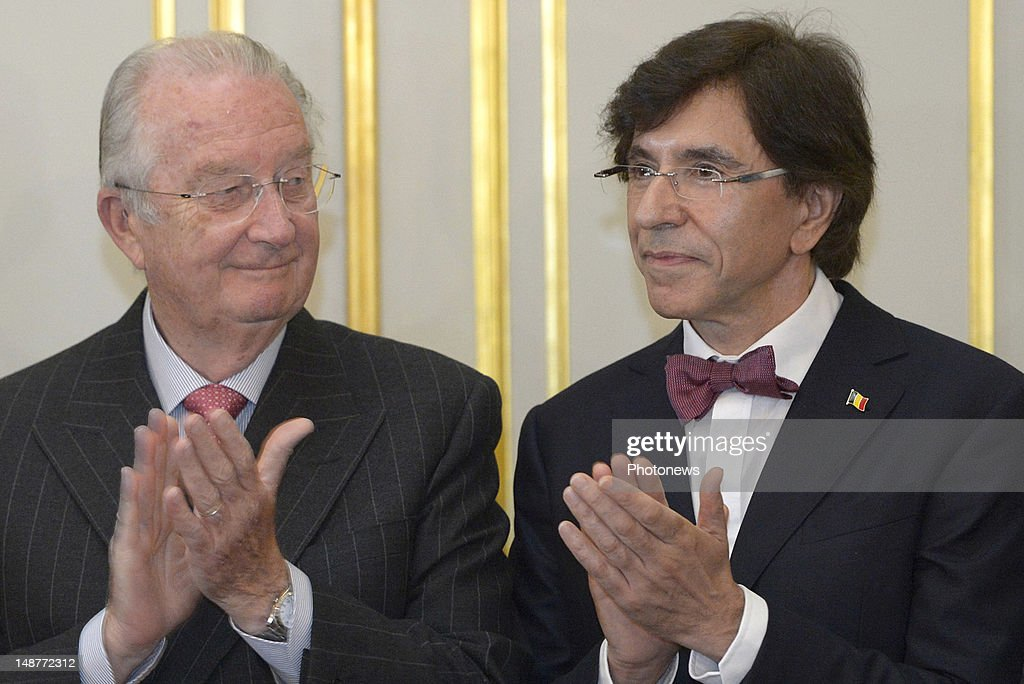 King Albert II and Prime Minister Elio Di Rupo applaud after the signing of the new institutional reforms with all the ministers of the Belgian Government on July 19, 2012 in Brussels, Belgium.