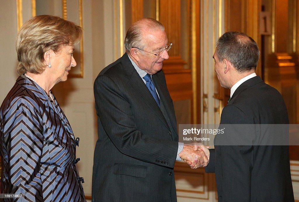 King Albert II (C) and Queen Paola of Belgium meet Russian Ambassador Alexander Alexandrovich Romanov during a New Year reception at Palais de Bruxelles on January 9, 2013 in Brussel, Belgium.