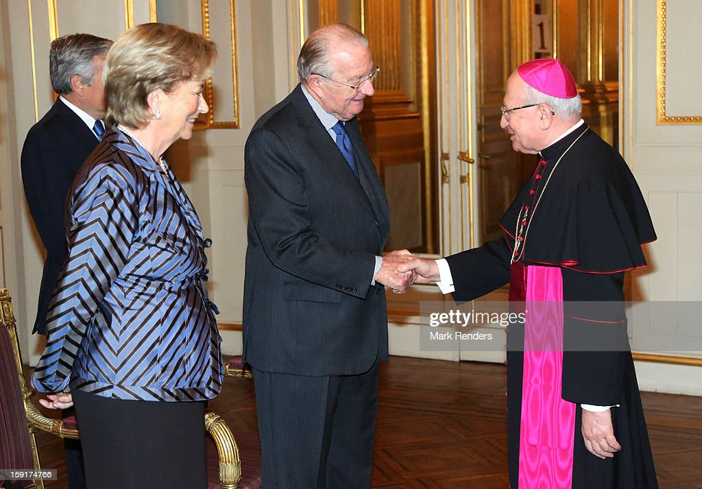 King Albert II (C) and Queen Paolaof Belgium and Nonce Apostolique Giacinto Berloco attend a New Year Reception at Palais de Bruxelles on January 9, 2013 in Brussel, Belgium.