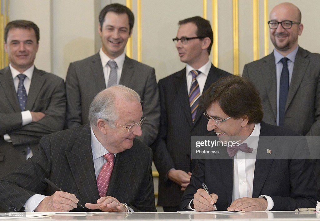 King <a gi-track='captionPersonalityLinkClicked' href=/galleries/search?phrase=Albert+II+of+Belgium&family=editorial&specificpeople=159444 ng-click='$event.stopPropagation()'>Albert II of Belgium</a> and Prime Minister <a gi-track='captionPersonalityLinkClicked' href=/galleries/search?phrase=Elio+Di+Rupo&family=editorial&specificpeople=743705 ng-click='$event.stopPropagation()'>Elio Di Rupo</a> sign the new institutional reforms as Ministers Charles Michel, Wouter Beke, Alexander De Croo, Benoit Lutgen stand behind on July 19, 2012 in Brussels, Belgium.