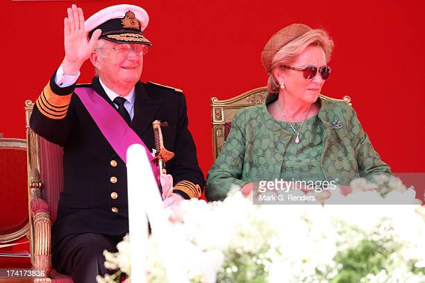 King Albert II of Belgium and Queen Paola of Belgium seen during the Civil and Military Parade during the Abdication Of King Albert II Of Belgium...