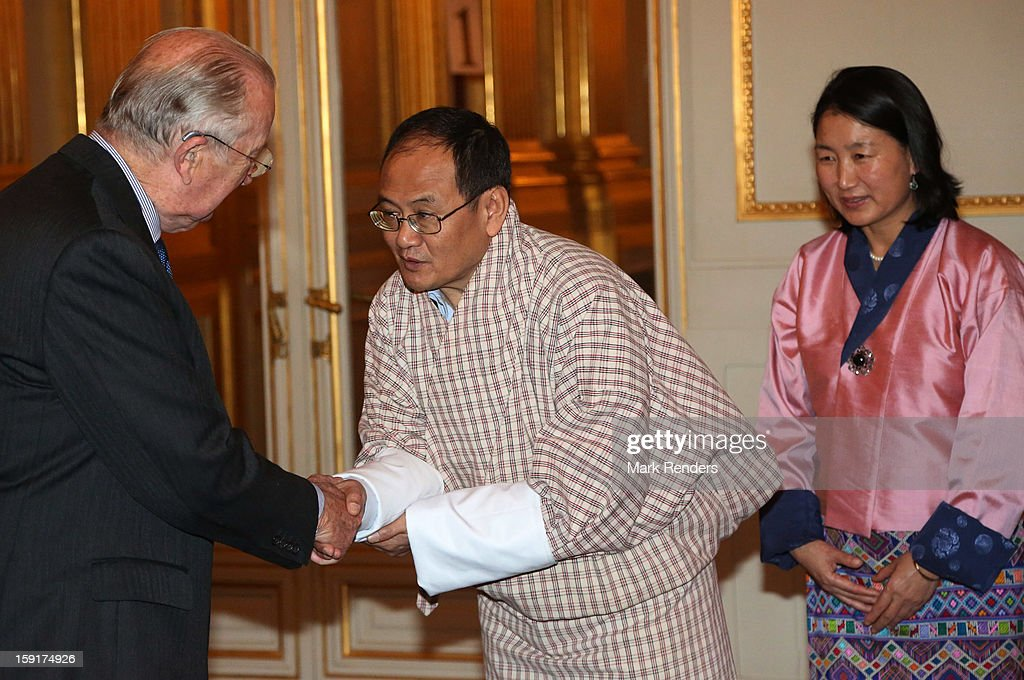King Albert II of Belgium meets Bhutanese Ambassador Sonam Tshong during a New Year reception at Palais de Bruxelles on January 9, 2013 in Brussel, Belgium.