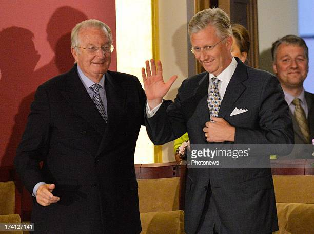 King Albert II of Belgium Princess Claire of Belgium look on as Prince Philippe of Belgium speaks as they attend an evening of concerts the 'Bal...