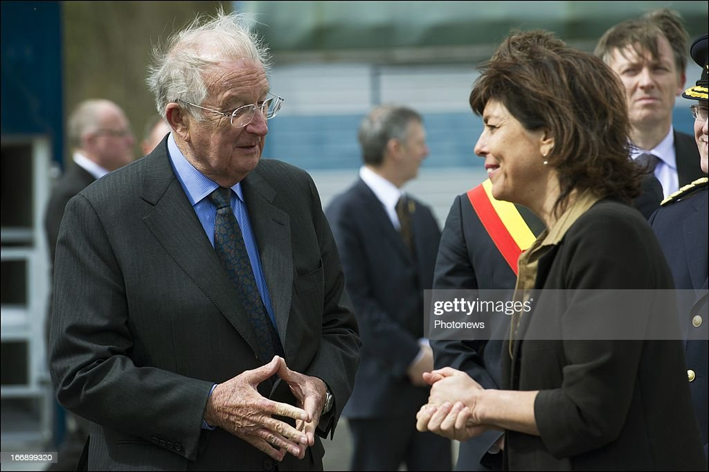 King Albert II of Belgium speaks with Minister of Interior Affairs, Joelle Milquet (R) during his visit to the Civilian Protection Unit in Ghlin on April 18, 2013 in Ghlin, Belgium.
