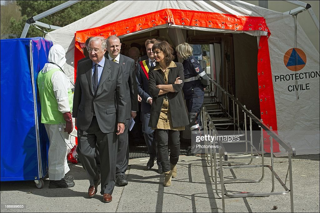 King Albert II of Belgium walks with Minister of Interior Affairs, <a gi-track='captionPersonalityLinkClicked' href=/galleries/search?phrase=Joelle+Milquet&family=editorial&specificpeople=4324706 ng-click='$event.stopPropagation()'>Joelle Milquet</a> (R) during his visit to the Civilian Protection Unit in Ghlin on April 18, 2013 in Ghlin, Belgium.