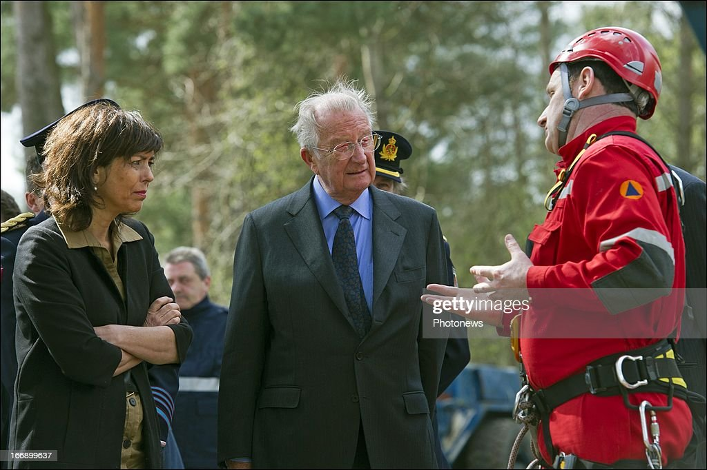 King Albert II of Belgium (C) with Minister of Interior Affairs, <a gi-track='captionPersonalityLinkClicked' href=/galleries/search?phrase=Joelle+Milquet&family=editorial&specificpeople=4324706 ng-click='$event.stopPropagation()'>Joelle Milquet</a> (L) during his visit to the Civilian Protection Unit in Ghlin on April 18, 2013 in Ghlin, Belgium.