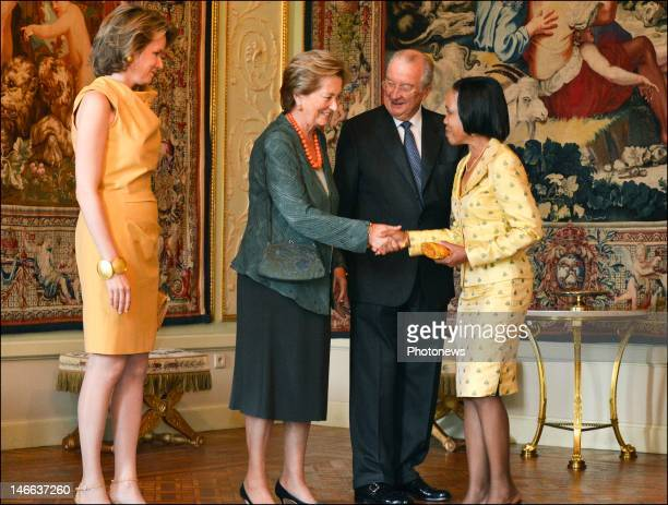 King Albert II Queen Paola and Princess Mathilde of Belgium shake hands with a diplomat at Laeken Castle on June 20 2012 in Brussels Belgium