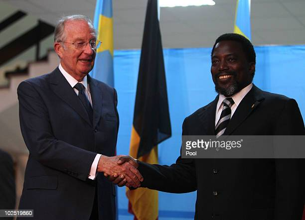 King Albert of Belgium and Congolese President Joseph Kabila shake hands at the Palais des Nations on 28 June 2010 in Kinshasa Congo King Albert and...