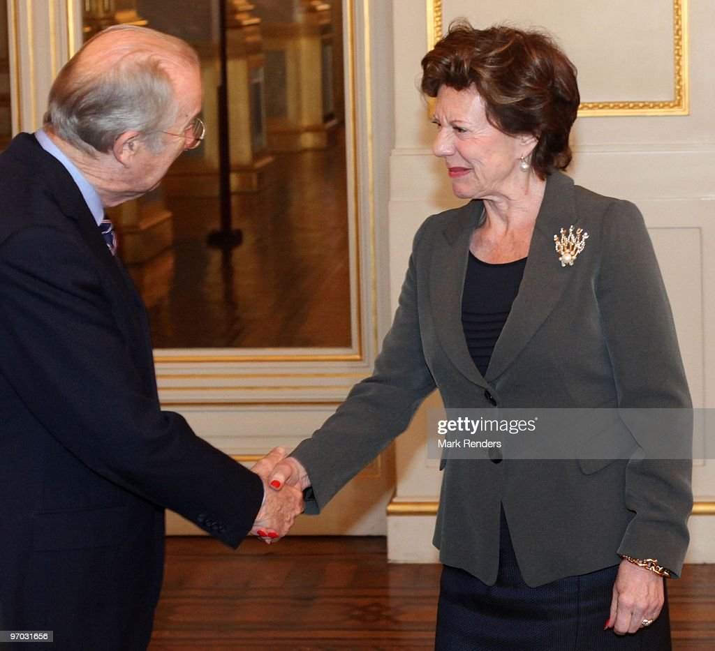 King Albert of Belgium (L) shakes hands with EC Vice President <a gi-track='captionPersonalityLinkClicked' href=/galleries/search?phrase=Neelie+Kroes&family=editorial&specificpeople=754723 ng-click='$event.stopPropagation()'>Neelie Kroes</a> during a reception for the European Authorities at the Royal Palace on February 24, 2010 in Brussels, Belgium.