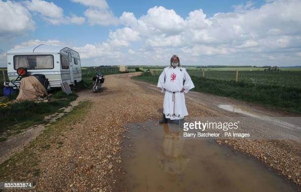 King Arthur Pendragon stands between his caravan and Stonehenge on the right after a judge evicted him from his livein protest site at Stonehenge