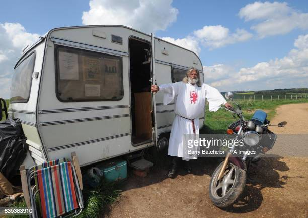 King Arthur Pendragon stands by his caravan near to Stonehenge after a judge evicted him from his livein protest site at Stonehenge