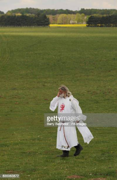 King Arthur Pendragon walks close to Stonehenge after a judge evicted him from his livein protest site at Stonehenge
