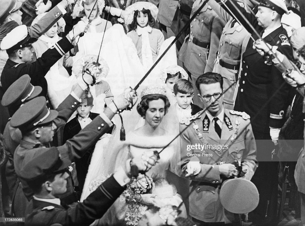King Baudouin of Belgium and Queen Fabiola of Belgium leave their wedding ceremony under the swords of officers of the Belgian Army Cathedral of St...