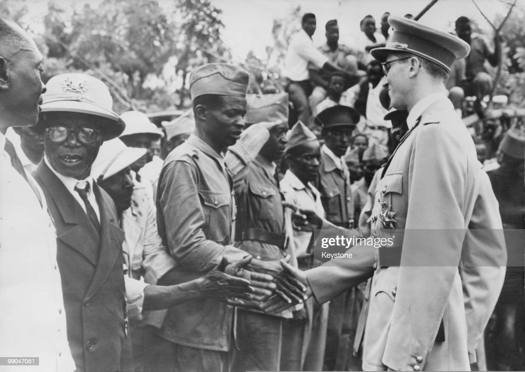 King Baudouin of Belgium (1940 - 1993) shakes hands with local people on his arrival in Bukavu, Belgian Congo, 31st December 1959.