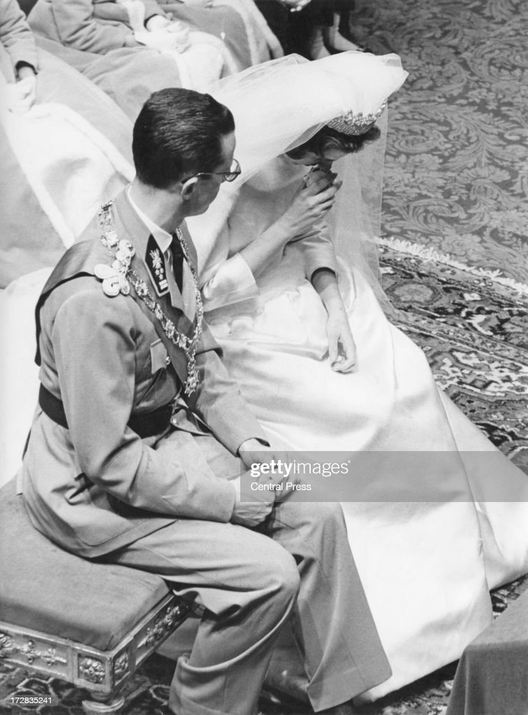 King Baudouin of Belgium shows concern for his bride Queen Fabiola of Belgium as she uses smelling salts during their wedding ceremony at the...