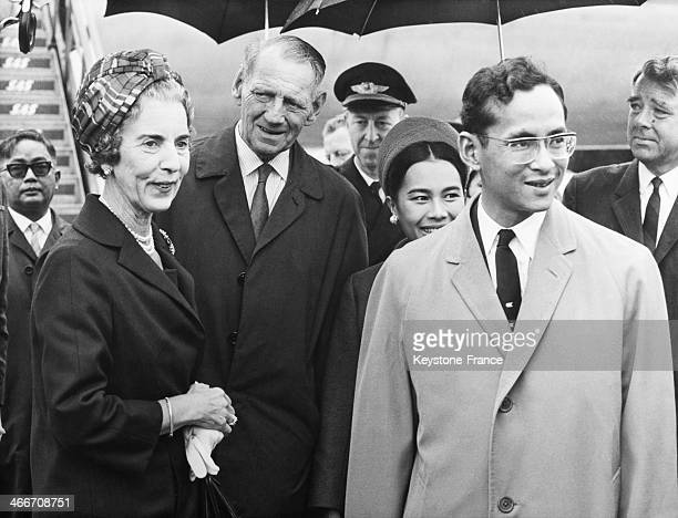 King Bhumibol Adulyadej of Thailand aka Rama IX and wife Queen Sirikit Kitiyakara welcomed by King Frederick IX of Denmark and wife Queen Ingrid of...
