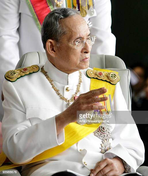 King Bhumibol Adulyadej of Thailand waves to wellwishers as he leaves the Siriraj Hospital on his 82nd birthday on December 5 2009 in Bangkok...