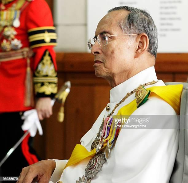 King Bhumibol Adulyadej of Thailand waves to wellwishers as he leaves the Siriraj Hospital on his 82nd birthday on December 5 2009 in Bangkok...