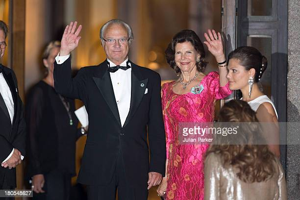 King Carl Gustaf and Queen Silvia of Sweden arrive at the Swedish Riksdag's concert to celebrate King Carl Gustaf of Swedens 40th Jubilee at...