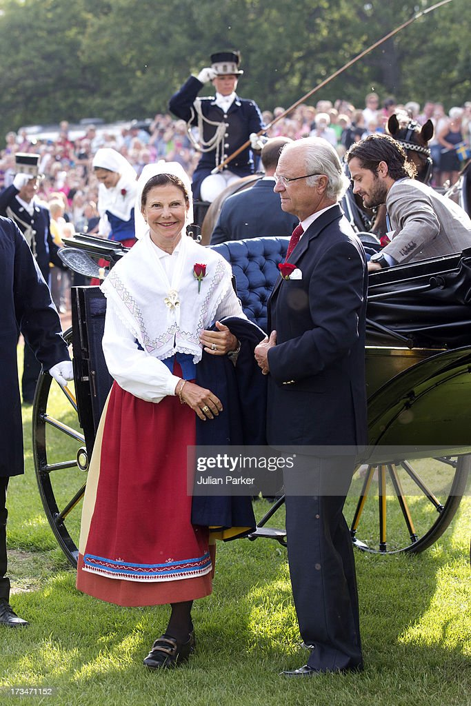 King Carl Gustaf, and <a gi-track='captionPersonalityLinkClicked' href=/galleries/search?phrase=Queen+Silvia+of+Sweden&family=editorial&specificpeople=160332 ng-click='$event.stopPropagation()'>Queen Silvia of Sweden</a> attend The Victoria Day Concert in Borgholm, on Crown Princess Victoria of Sweden's 36th Birthday on July 14, 2013 in Borgholm, Sweden.