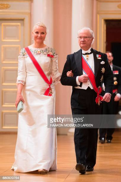 King Carl Gustaf of Sweden and Crowm Princess MetteMarit of Norway arrive for a gala dinner at the Royal Palace in Oslo Norway on May 9 2017 to mark...