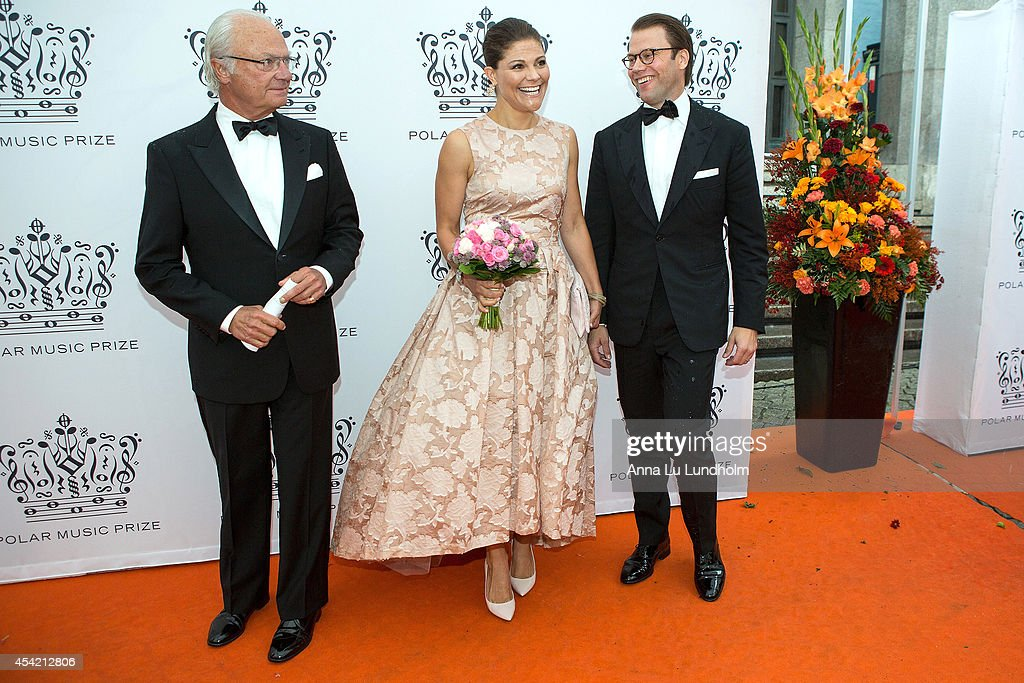 King Carl Gustaf of Sweden and <a gi-track='captionPersonalityLinkClicked' href=/galleries/search?phrase=Crown+Princess+Victoria+of+Sweden&family=editorial&specificpeople=160266 ng-click='$event.stopPropagation()'>Crown Princess Victoria of Sweden</a> and Prince Daniel attend Polar Music Prize at Stockholm Concert Hall on August 26, 2014 in Stockholm, Sweden.