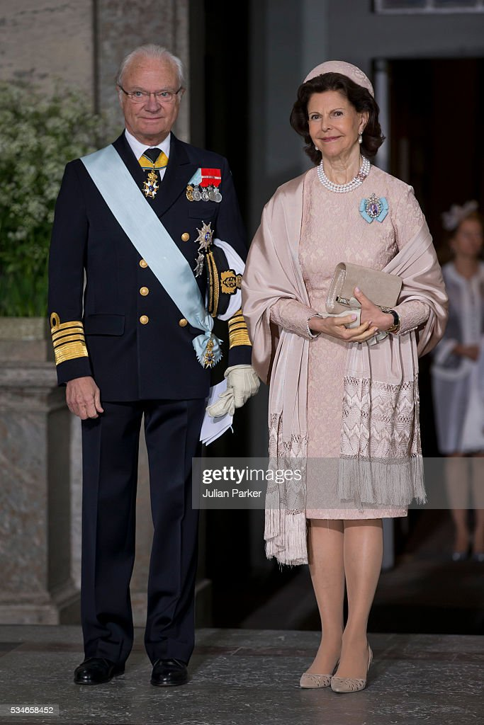 King Carl Gustaf of Sweden, and <a gi-track='captionPersonalityLinkClicked' href=/galleries/search?phrase=Queen+Silvia+of+Sweden&family=editorial&specificpeople=160332 ng-click='$event.stopPropagation()'>Queen Silvia of Sweden</a> attend the christening of Prince Oscar of Sweden at the Royal Palace in Stockholm on May 27, 2016 in Stockholm, Sweden.