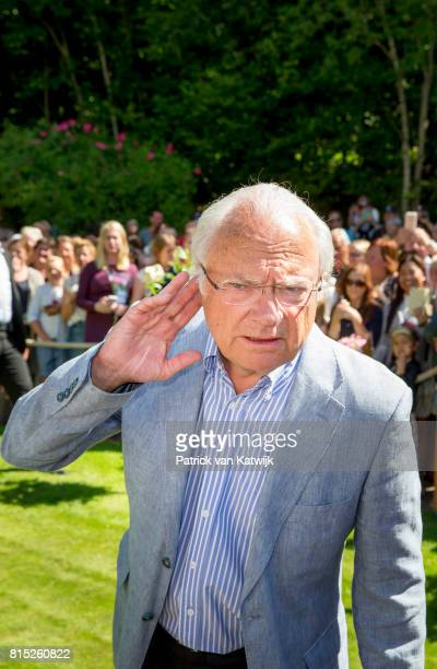 King Carl Gustaf of Sweden is seen meeting the people gathered in front of Solliden Palace to celebrate the 40th birthday of Crown Princess Victoria...