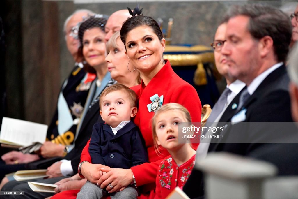 King Carl Gustaf of Sweden, Queen Silvia, Erik Hellqvist, Marie Hellqvist, Crown princess Victoria with Prince Oscar, Prince Daniel and Mr Christopher O'Neill attend baby Prince Gabriel's christening in Drottningholm Palace Chapel outside Stockholm, 1 December, 2017. Prince Gabriel is the second son of Prince Carl Philip and Princess Sofia of Sweden. / AFP PHOTO / TT News Agency / Jonas EKSTROMER / Sweden OUT